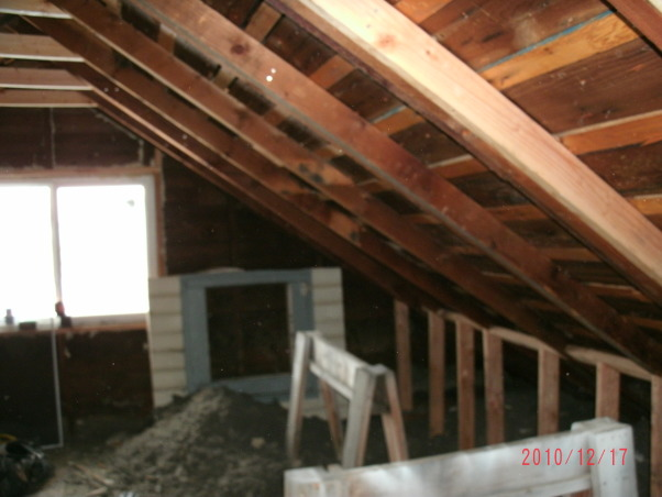 Attic Remodel, A fairly large attic is being converted into a Office/Craft/Den, a Bathroom, Bedroom and storage. Walls are up, all wired, insulation is done, working on sheet rock, (hard to do with 1 and 1/2 arms). Will have built in desk, sewing table and craft storage. , out come the attic vent, in goes a new window.  , Other Spaces Design