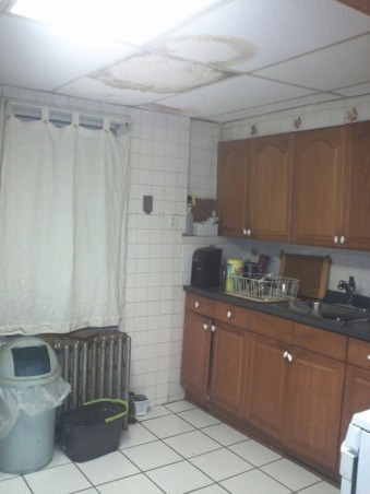 terrifying white kitchen, my old kitchen with white subway tiles all around and an unfinished laundry space, an awful drop down ceiling in my kitchen, Kitchens Design