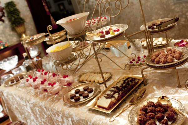 Dining Table Dessert Layout, Designing a dessert table lay-out in gold!  , Several plant stands of varying heights were painted gold and serve as great center pieces for a display of desserts.       , Dining Rooms Design