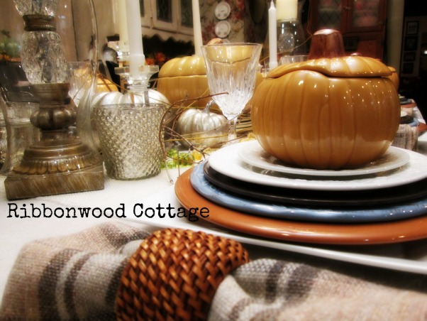 Mercury Glass Tablescape for Fall, We live in a farmhouse with a small dining area. I love to set the table to change the look of the dining area in our farmhouse., Our fall table in our farmhouse. Using several different colored fall plates stacked on one another, ending with a pumpkin soup bowl with lid. Center piece has (faux)mercury glass pumpkins and candle holders. For a natural look I added honeysuckle vines. Plaid napkins and napkin rings complete the look., Dining Rooms Design