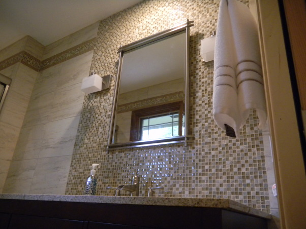 Master Bath, Small master bath remodel. We love tile and had a lot of fun creating the design. , A bank of mosiac tile with contemporary lighting and mirror creates a fun new look in the small space. , Bathrooms Design