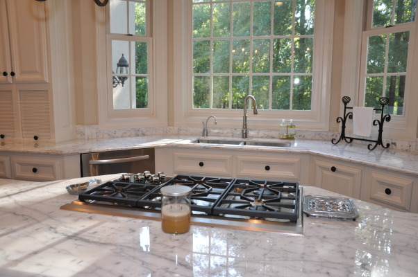 Modern French Marble Kitchen, We loved the layout of our kitchen but it needed updating from the 1980's tile counter tops and colors. Thanks to Vision Works Construction 404-837-1492 http://www.visionworksconstruction.com/id67.html, Wolf 5 burner gas cooktop, 50/50 Blanco steel art sink with Insinkerator hot water dispenser and Kohler faucet , Kitchens Design