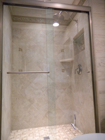 Master Bath, Small master bath remodel. We love tile and had a lot of fun creating the design. , Because our home is more traditional, we chose a more traditional partner of 12 by 12 tiles inside the shower. The mosiac accents help to tie the design into the rest of the bathroom's design., Bathrooms Design