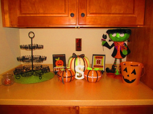 "Tricks and Treats!, Decorating for the Holidays is one my favorite things to do! Many of my ideas were inspired by HGTV and other Rate My Space members. These are my new creations for this Fall and Halloween., My Halloween candy corner in my kitchen :) Making Cup""fakes"" soon to put on my cupcake stand. , Holidays Design"