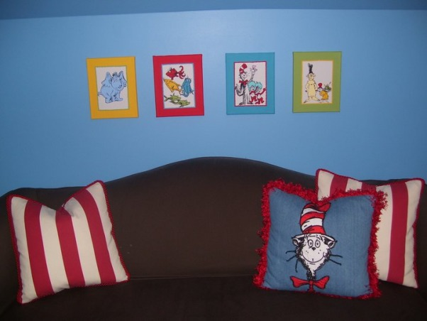 Dr. Seuss Inspired Playroom!, We created a bold, fun, Dr. Seuss inspired playroom for our son. We used bright colors, stripes and brought in all of his favorite Seuss characters. We painted the entire back wall with chalkboard paint, and a made a big storage unit and fun little reading nook!, Etsy Seuss paintings.   , Other Spaces Design