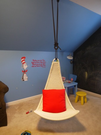 Dr. Seuss Inspired Playroom!, We created a bold, fun, Dr. Seuss inspired playroom for our son. We used bright colors, stripes and brought in all of his favorite Seuss characters. We painted the entire back wall with chalkboard paint, and a made a big storage unit and fun little reading nook!, Ikea swing!   , Other Spaces Design