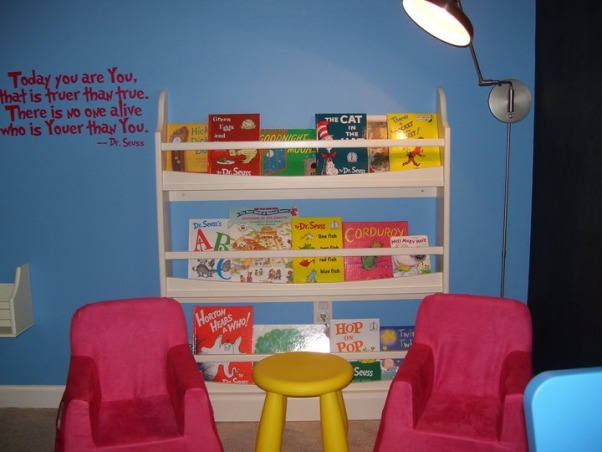 Dr. Seuss Inspired Playroom!, We created a bold, fun, Dr. Seuss inspired playroom for our son. We used bright colors, stripes and brought in all of his favorite Seuss characters. We painted the entire back wall with chalkboard paint, and a made a big storage unit and fun little reading nook!, Reading nook!   , Other Spaces Design