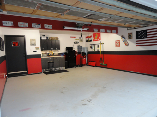 GT500 Updated Garage, My husband wanted to do a garage makeover. We did it on a budget - all of the cabinets are from the Habitat for Humanity Restore. The posters down the left wall I designed of all of his past cars. I let him choose and hang all of the other decorations. , Other Spaces Design