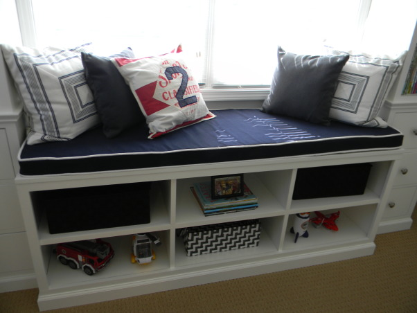 Beckham's New Room, Beckham's dad built all the furniture in the room.  The window treatments and pillows were custom designed.  He moved up to this big boy room to make room for his little brother., Close up of cubbies on window seat, Boys' Rooms Design