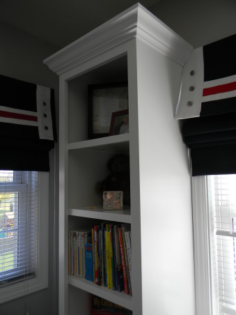 Beckham's New Room, Beckham's dad built all the furniture in the room.  The window treatments and pillows were custom designed.  He moved up to this big boy room to make room for his little brother., Detail view of the bookshelves, Boys' Rooms Design