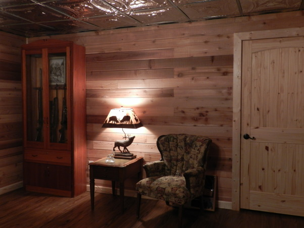 Western Basement Home Office, This is a basement space where I created my husband's home office.  It has a suspended tin ceiling, horse tapestry from Italy, Antiques, Family Heirlooms, Frederic Remington sculptures, handmade bookcase, wagonwheel chandelier, Western Style because my husband is a Farrier., Handmade Gun Cabinet, Antique wingback chair (recovered), Elk lamp, leather covered end table, Basements Design