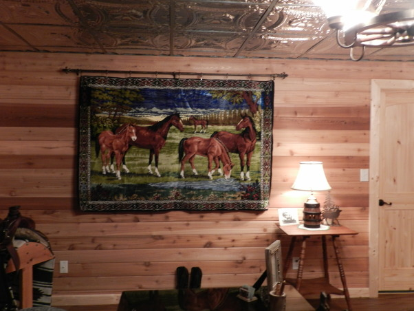 Western Basement Home Office, This is a basement space where I created my husband's home office.  It has a suspended tin ceiling, horse tapestry from Italy, Antiques, Family Heirlooms, Frederic Remington sculptures, handmade bookcase, wagonwheel chandelier, Western Style because my husband is a Farrier., Antique Horse Tapestry from Italy, Basements Design