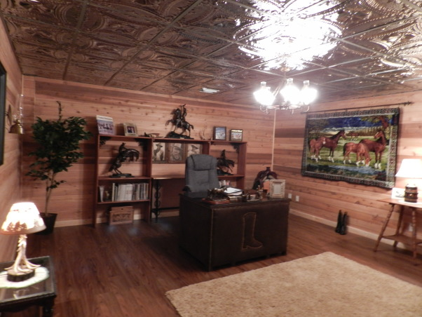Western Basement Home Office, This is a basement space where I created my husband's home office.  It has a suspended tin ceiling, horse tapestry from Italy, Antiques, Family Heirlooms, Frederic Remington sculptures, handmade bookcase, wagonwheel chandelier, Western Style because my husband is a Farrier., Western home office, Basements Design