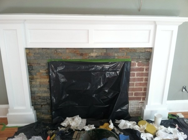 Fireplace makeover, My fireplace mantel surround was ugly so I decide it was time to build my own to give my newengland home it's Charm back!, Motar stacked slate over the damage brick., Living Rooms Design