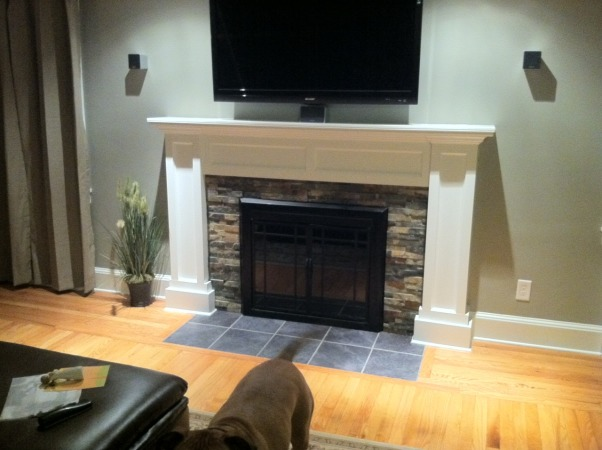 Fireplace makeover, My fireplace mantel surround was ugly so I decide it was time to build my own to give my newengland home it's Charm back!, Two down lights over tv and all components in basement. , Living Rooms Design
