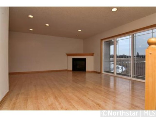 Help - how do I furnish a great room (livingroom/diningroom combined)???, I just purchased a new townhome and love the open space of the great room, but I have NO idea how to furnish it !!  It has a corner fireplace that I'd love to enclose, but won't have the funds right away. Until that time, I need to work with it.  I don't want to put a t.v. above it, so was thinking of a tall media/shelving unit on the wall between the fireplace and kitchen.  A couch could face that wall, with a long console or two behind it.  The dining room table would be in the forefront of the photo.  All suggestions and comments welcome !!  Thanks in advance, I'm stumped., View across the great room towards the corner fireplace., Living Rooms Design