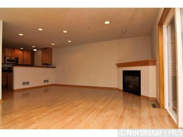 Help - how do I furnish a great room (livingroom/diningroom combined)???, I just purchased a new townhome and love the open space of the great room, but I have NO idea how to furnish it !!  It has a corner fireplace that I'd love to enclose, but won't have the funds right away. Until that time, I need to work with it.  I don't want to put a t.v. above it, so was thinking of a tall media/shelving unit on the wall between the fireplace and kitchen.  A couch could face that wall, with a long console or two behind it.  The dining room table would be in the forefront of the photo.  All suggestions and comments welcome !!  Thanks in advance, I'm stumped., The view coming up the entry stairs., Living Rooms Design
