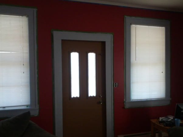 Need Help with Boring Living Room!!, Recently painted the boring living room a cranberry color and we love it. I need some help picking the color for the trim and also whether to stencil the ceiling or one of the walls. I've seen others do a stencil in the same color only high gloss on a wall. Have you done this? , Front Door view, sorry about the lighting and still have the painters tape up. Lol.  , Living Rooms Design