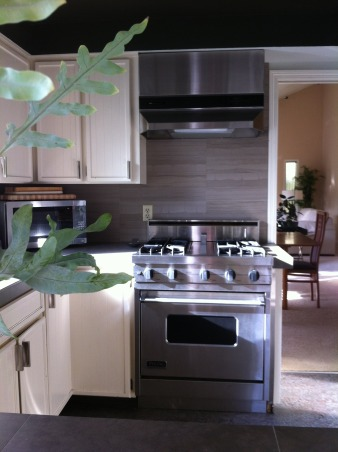 Guy's Kitchen, Redo on a budget, we left our original cabinets and painted them, added new appliances ,Marmoleum flooring, large format tile on counters and splurges on a limestone backsplash. Appliances were replaced , Kitchens Design