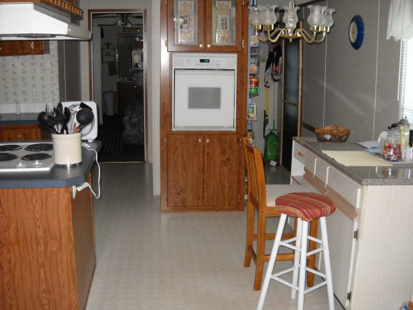 Impractical mess, Offset workspace, out of place oven,near dining area, laminated counters and not enogh cabinet plus the striped/flower wallpaper on my side of the kitchen., oven in dining area, bad floor plan, Kitchens Design