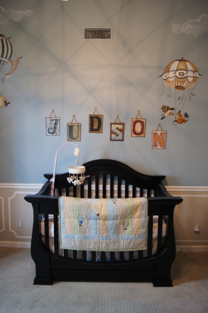Hot Air Balloon Animal Nursery , I created and designed this nursery for my son who was born in June. Each corner of the room contains a story to be told. I wanted something timeless that could age with my son. I designed and hand painted each animal creating a custom balloon for them to sit in. I have an extensive background in art, Faux finishing and design. So this project filled me with passion and i wanted to showcase my abilities for my son. Originally our office, this room has completely changed. I added a chair rail and used serene paint colors for my palette back drop to the animal balloons. With high ceilings, I made these custom linen draperies to add some height and drama to the room. The chandelier was chosen to mimic the look of the balloons on the wall. I created the art over the changing station in photo shop. I could not find the right colors, so I combined vintage pictures of hot air balloons and my quote for my son. Then framed them in silver with mats to tie in the colors. i found the cool metal tiles over the crib at a craft store and tweeked the colors with some acrylic paint to go with the theme and added some twine for an organic flare.   , Nurseries   Design