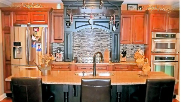 Old World Style with new world charm , Cabinetry is rustic alder in whiskey black glaze, and the Hearth and Island is in maple with black heirloom paint . this Kitchen is a small space with a big impact , Kitchens Design