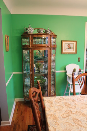 Green Eclectic Dining Room for Fall, Hi - This is our dining room that we recently repainted. I know the color might not be for everyone but we love color in our home and so I went for it.  While it worked well for Spring and Summer, I have having trouble decorating for fall.  The style is a bit eclectic as well but I am hoping that this pulled together. in the end.    I am open to suggestion- like should I hang something above each of the turquoise chairs.  I appreciate your thoughts. , Dining Rooms Design