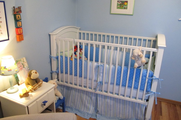 "Tiny, Budget Friendly, Sweet and Simple Baby Boy Room, When I was expecting my son I didn't want a ""themed"" room and I didn't want brown in the bedding, which was all that I could find.  I am not a designer, but I got tons of inspiration from looking at nurseries on Rate My Space and other websites.  Most of the furniture and the rug were found on Craigslist and the bedding and curtains were designed and made by me.  The quilt was a gift and was designed to match.  The room is only 8x8 feet.  We love how sweet and simple it turned out and it has served us well.  I wanted to take pictures and document it because it has been such a special space and we are getting ready to move into a big boy room to be shared with a new brother., Pottery Barn Crib was a Craigslist find.  Crib bedding designed and sewn by Mama because she couldn't find any that she liked.  Farm print purchased from an artist on the Charles Bridge while visiting Prague.     , Nurseries Design"