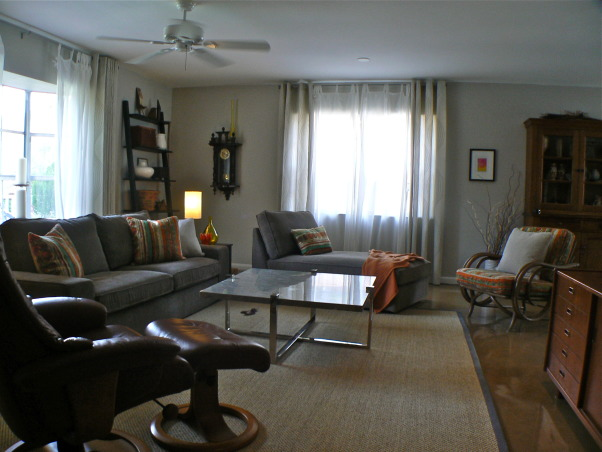 Change for the seasons, 15 x 19 Living/Family room area painted in Dove grey. Ikea sofa/sectional in grey-brown cordoroy covers, Classic slope arm chair, old wood bench/coffee table, teak end tables in separate styles, Stressless recliner. Blend of old and new . Refinished concrete floors with sisal area rug. Kids and cat friendly!, I decided to rearrange the living room a bit. I do that from time to time. Now the Hubby can fall asleep on the sofa watching the football game and I can have the recliner...sneaky ya think?   , Living Rooms    Design