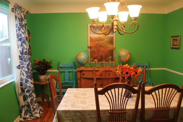 Green Eclectic Dining Room for Fall, Hi - This is our dining room that we recently repainted. I know the color might not be for everyone but we love color in our home and so I went for it.  While it worked well for Spring and Summer, I have having trouble decorating for fall.  The style is a bit eclectic as well but I am hoping that this pulled together. in the end.    I am open to suggestion- like should I hang something above each of the turquoise chairs.  I appreciate your thoughts. , found the globe lamps at a thrift store  - wall seems bare over the chairs, Dining Rooms Design