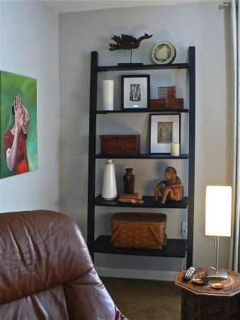 Change for the seasons, 15 x 19 Living/Family room area painted in Dove grey. Ikea sofa/sectional in grey-brown cordoroy covers, Classic slope arm chair, old wood bench/coffee table, teak end tables in separate styles, Stressless recliner. Blend of old and new . Refinished concrete floors with sisal area rug. Kids and cat friendly!, A few of the various items I've kept over the years.  Artwork from the New England coast, various wooden boxes, baskets and such. An oil painting of my daughter's hands.   , Living Rooms    Design
