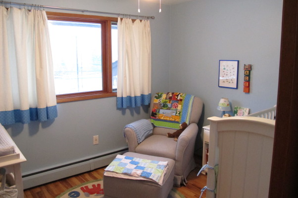 "Tiny, Budget Friendly, Sweet and Simple Baby Boy Room, When I was expecting my son I didn't want a ""themed"" room and I didn't want brown in the bedding, which was all that I could find.  I am not a designer, but I got tons of inspiration from looking at nurseries on Rate My Space and other websites.  Most of the furniture and the rug were found on Craigslist and the bedding and curtains were designed and made by me.  The quilt was a gift and was designed to match.  The room is only 8x8 feet.  We love how sweet and simple it turned out and it has served us well.  I wanted to take pictures and document it because it has been such a special space and we are getting ready to move into a big boy room to be shared with a new brother., Glider rocker was a Craigslist find in new condition for only $75.     , Nurseries Design"