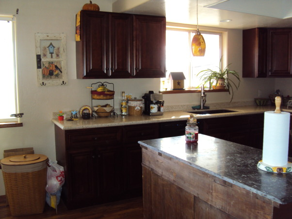 from the old to the new, total kitchen makeover with dark mahogany cabinets and recycled countertops., Mahogany cabinets and recycled countertops give the kitchen a rich modern look., Kitchens Design