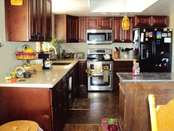 from the old to the new, total kitchen makeover with dark mahogany cabinets and recycled countertops., Moving the stove over to the wall helpedopen the area up. Cork flooring gives comfort on concrete floors., Kitchens Design