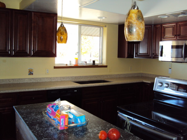 from the old to the new, total kitchen makeover with dark mahogany cabinets and recycled countertops., we installed recessed lighting and pendant lights over the island., Kitchens Design