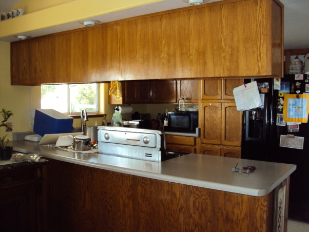 from the old to the new, total kitchen makeover with dark mahogany cabinets and recycled countertops., our kitchen was dark and enclosed. Vision from the kitchen to the dining room was limited., Kitchens Design