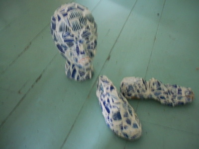 collections of blue and white china, this decorative pieces have been created using a hat form and shoe lasts and broken bits of blue and white china, Kitchens Design