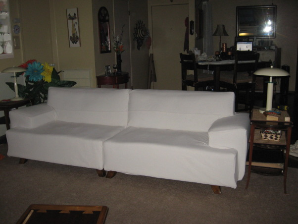 "Canvas drop cloth sofa slipcover, I couldn't afford to reupholster this sectional so I covered it with a drop cloth slipcover. I had previously covered the cushions in the orange fabric and will make canvas ones also., sectional as one long(102""sofa, Living Rooms Design"