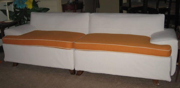 Canvas drop cloth sofa slipcover, I couldn't afford to reupholster this sectional so I covered it with a drop cloth slipcover. I had previously covered the cushions in the orange fabric and will make canvas ones also., I staple the edges to the base of the sofa. Made the cushions before and will make covers out of drop cloths., Living Rooms Design