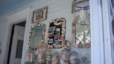 a shell decorated screened porch, shell  trimmed mirrors and jars of shells decorate small summer porch, Porches Design