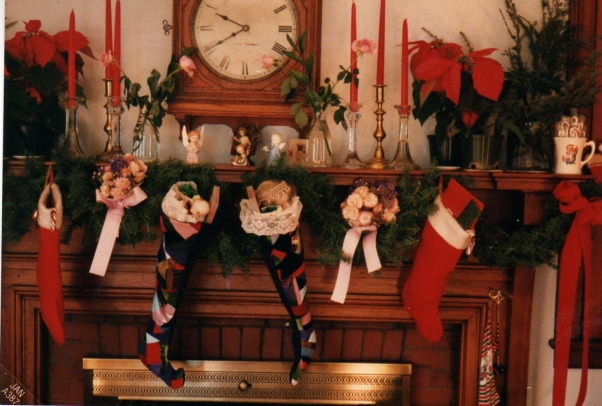 more mantel pieces, changing mantelpieced, a Christmas mantel with home made patchwork stockings , Living Rooms Design