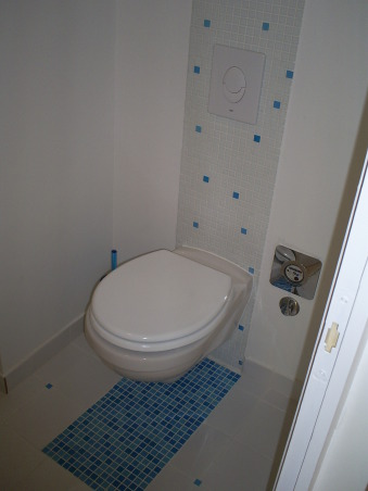Funny, fresh and functional, The bathroom was renovated for a student as a part of her first own home.  Wanted to make this small bathroom functional, fresh and funny with a girly twist.  See also how it looked before the make-over..., Mosaics makes a rug under the toilet., Bathrooms Design