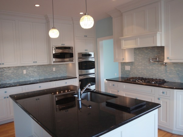 Jersey Shore Kitchen, Used a beach glass color scheme in the whole house for a soothing beach retreat., The black granite countertops make a statement against all of the pastel colors in the house.  They are repeated in all of the bathrooms., Kitchens Design