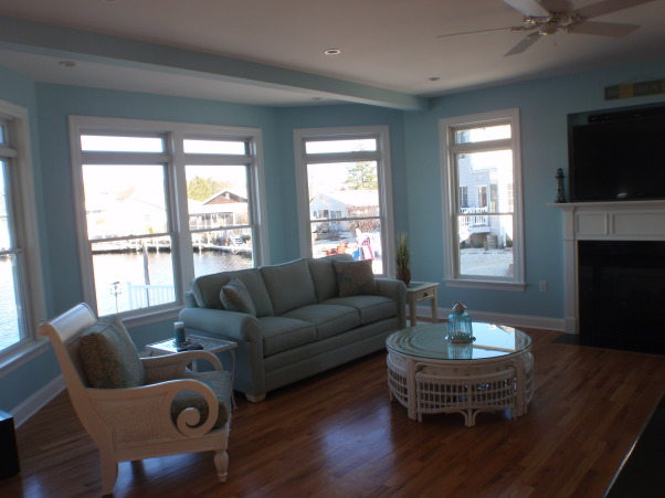Jersey Shore Living Room, This is more of a great room because it includes the dining area and kitchen in one big room.  The house is on the water so I used beach glass colors throughout for a clean, airy feel that matches its surroundings., Living Rooms Design