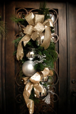 Home for the Holidays in TEXAS!, overstuffed christmas tree and garland to boot!  Large ornaments with lots of ribbon and clear balls can make a grand impression., swag on each door., Holidays Design