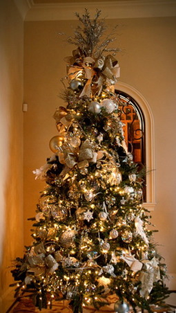 Home for the Holidays in TEXAS!, overstuffed christmas tree and garland to boot!  Large ornaments with lots of ribbon and clear balls can make a grand impression., 9 ft christmas tree with a 2 ft topper.  Overstuffed with large ornaments, large crystals and lots of glitter!, Holidays Design