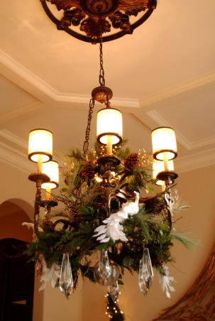 Home for the Holidays in TEXAS!, overstuffed christmas tree and garland to boot!  Large ornaments with lots of ribbon and clear balls can make a grand impression., I used a 9ft garland to intertwine through the chandelier, then adorned with crystals and birds., Holidays Design