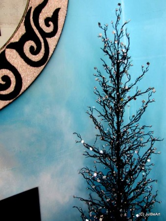 Holidays By The Sea 2, I posted this same space about three years ago, Christmas 09. I have not posted anything of late. Christmas 09 was the first time I stepped outside my comfort zone and used a white artificial Christmas tree instead of the traditional real trees I've always used. I hope you'll be inspired., This 5 ft tall, black tree has tons of tiny square mirrors, I call it my 'rock and roll' tree. I love the slim profile, great for those with space issues.   , Holidays Design