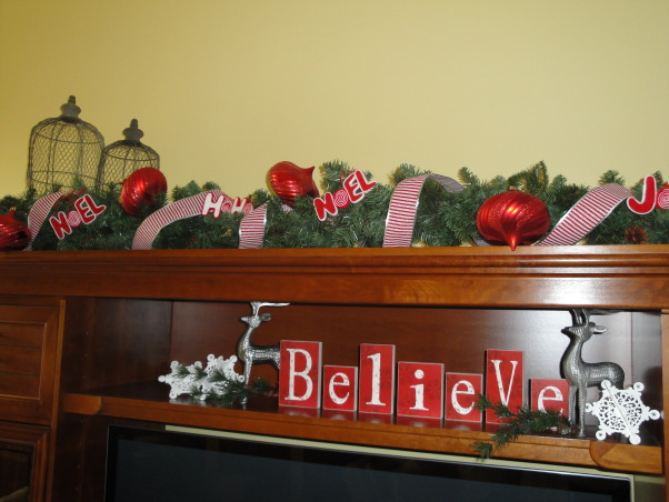 "Red, white and peppermint Christmas! , My living room and dinning room are all ready for Christmas.  I decked everything out in red and white.  , This is the top of our entertainment center. Love the letters.  I found those at HomeGoods last year and just love them!  My husband jokingly said, ""believe in what?""  The bulbs I found at the Christmas Tree Shops for $1.79 each!  , Holidays Design"
