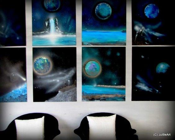 Holidays By The Sea 2, I posted this same space about three years ago, Christmas 09. I have not posted anything of late. Christmas 09 was the first time I stepped outside my comfort zone and used a white artificial Christmas tree instead of the traditional real trees I've always used. I hope you'll be inspired., Foyer- these eight space themed paintings were my inspiration for this decor. I got the idea for the black Christmas trees from the night skies in these paintings.   , Holidays Design
